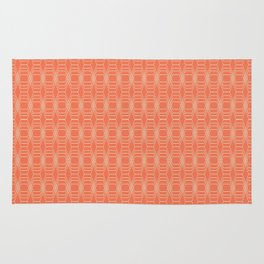 hopscotch-hex tangerine Rug