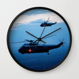 Support Helicopters Fly at Dusk Wall Clock