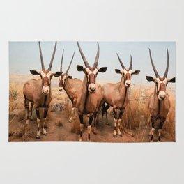 the herd at maasai mara-kenya Rug