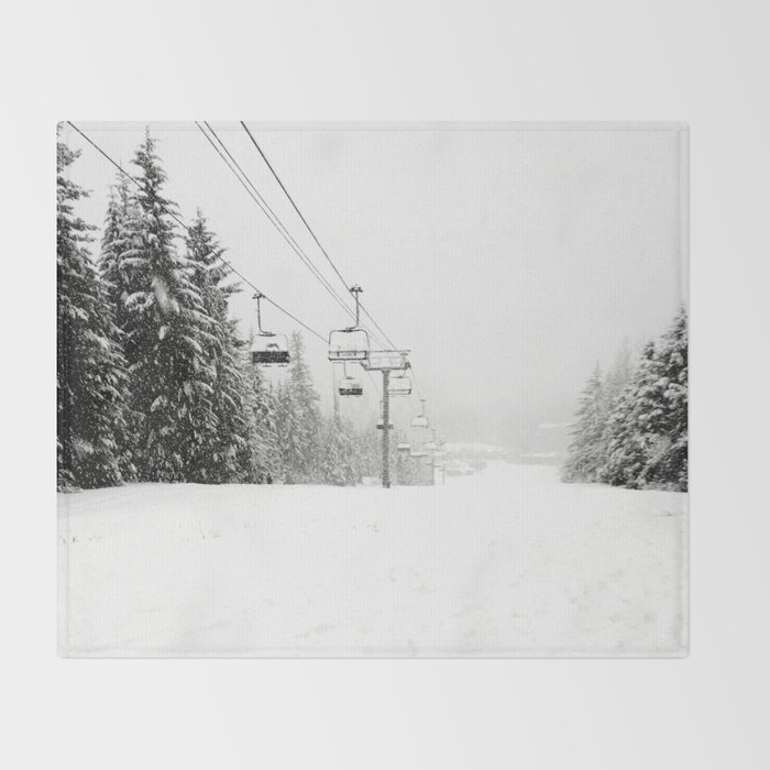 Lifts waiting for action in the snow Throw Blanket
