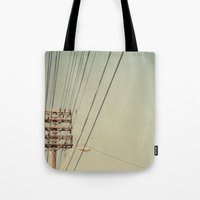 the wire Tote Bags featuring wire by erinreidphoto