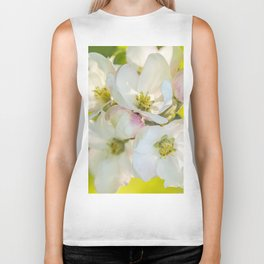 Close-up of Apple tree flowers on a vivid green background - Summer atmosphere Biker Tank