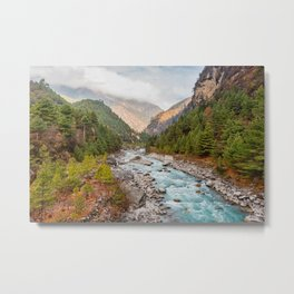 River flows through a Nepalese valleysurrounded by a green pine forest on a cloudy day. Metal Print
