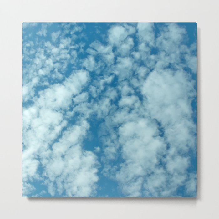 Fluffy clouds in a blue sky Metal Print