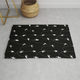 Invasion of the rock climbers (white on black) Rug