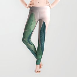 Tropical plants on pink background Leggings