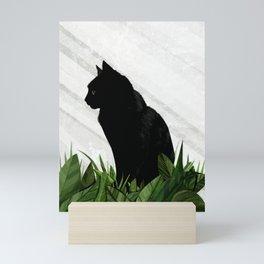 Black cat greenhouse Mini Art Print