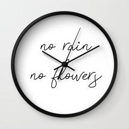 no rain no flowers Wall Clock