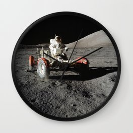 Astronaut Eugene A Cernan commander drives the Lunar Roving Vehicle during first Apollo 17 extravehi Wall Clock