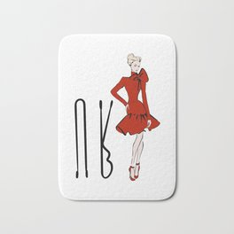 Girl in red dress with bobby pins Bath Mat