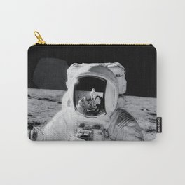 Astronaut Alan Bean holds Special Environmental Sample Container Carry-All Pouch