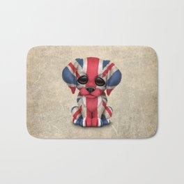 Cute Puppy Dog with flag of Great Britain Bath Mat