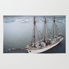 Sailing Ship in front of a Mountain Valley in Norway Rug