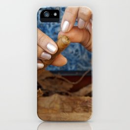 A cigar is lovingly finished.  iPhone Case