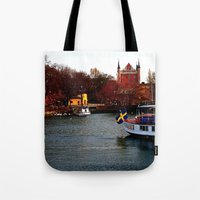 sweden Tote Bags featuring Stockholm, Sweden  by JuliHami