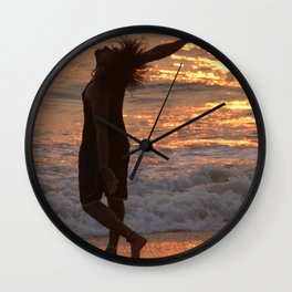 Dancing in the Surf at Sunset Wall Clock
