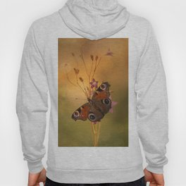 Peacock butterfly on bell flowers at sunset Hoody