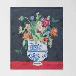 Bouquet of Flowers in Blue and White Urn on Navy Throw Blanket