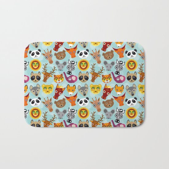 pattern with funny cute animal face on a blue background Bath Mat