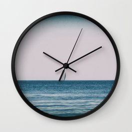 Solitary sailing boat in the mediterranean sea Wall Clock