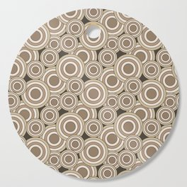 Overlapping Circles in Tans on Brown Cutting Board