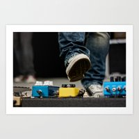 Chuck Taylor preps to activate pedal on guitar pedal board Art Print