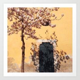 blooming tree on yellow wall background Art Print
