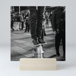 Standing on Static Bollards Mini Art Print