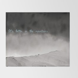 It's better in the mountains Throw Blanket