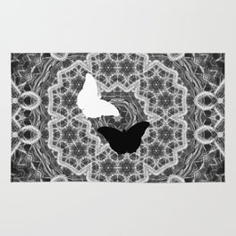 abstract wattle mandala and butterflies in black and white Rug