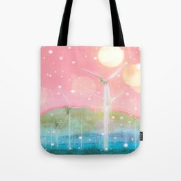 wind turbine in the desert with snow and bokeh light background Tote Bag
