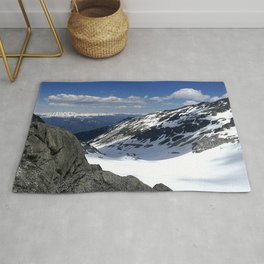 Mountains dappled with snow and rock Rug