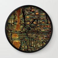 paris map Wall Clocks featuring Paris Map by Larsson Stevensem