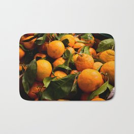 A Photo of Oranges with Green Stems Bath Mat