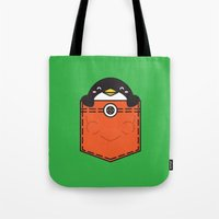 pocket Tote Bags featuring Pocket Penguin by Steven Toang