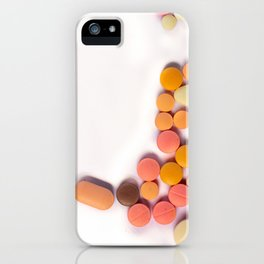 Numerous colorful pills on white background. iPhone Case