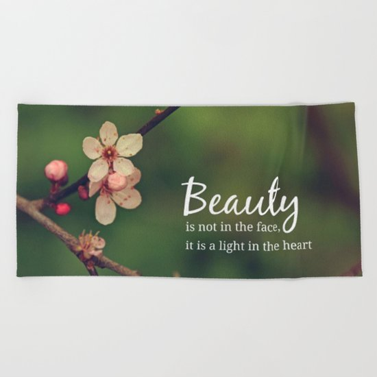 Beauty is in the heart Beach Towel