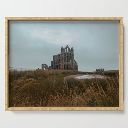 The ruins of church Whitby Abbey on top of a vast hill Serving Tray