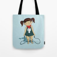 feminist Tote Bags featuring Feminist girl by Jihane Mazid