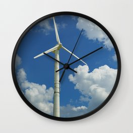 Wind Turbine Windmill in the Landscape with Yellow Colza Field and Blue Sky Wall Clock