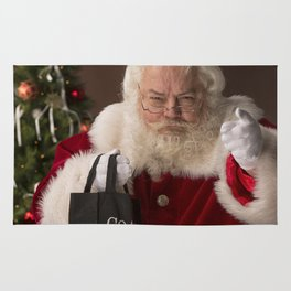 Santa Claus holding a coal bag and wondering if you have been naughty or nice Rug