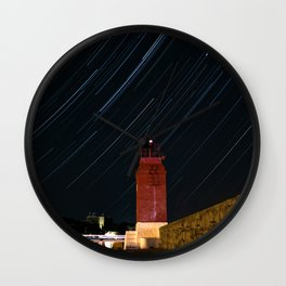 Lighthouse and star trails Wall Clock
