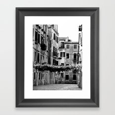 Vines across Venetian street Framed Art Print