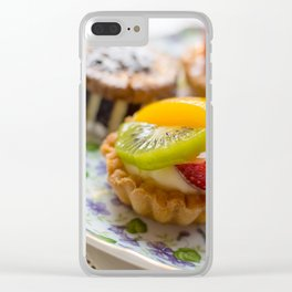 Small fruit tarts laid out on an antique china plate Clear iPhone Case