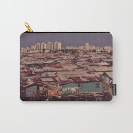 'MODERN BUILDINGS TOWER OVER THE SHANTIES CROWDED ALONG THE MARTIN PENA CANAL' Carry-All Pouch