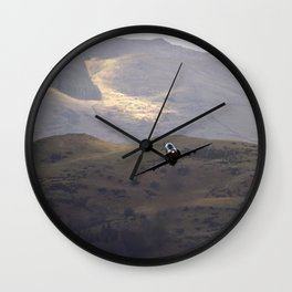 Flying over fields of gold Wall Clock