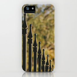 iron fence, yellow leaves iPhone Case