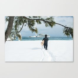 Lone Korean surfer heads out for a wave after a huge snow storm on the 38th Parallel, South Korea Canvas Print