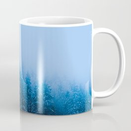 Fog over snow covered forest at lake Bohinj, Slovenia Coffee Mug