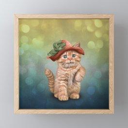 Little funny striped kitten in a big hat Framed Mini Art Print